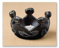 """As a gift to yourself or others, this primitive inspired work of art radiates the warmth and feeling of friendship. Smoothly carved from a single piece of midnight shaded soapstone, the size and shape lend to being a votive holder or catch all at the desk. 5"""" dia. x 3""""H."""