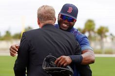 Boston Red Sox designated hitter David Ortiz, right, hugs Sox pitching great Curt Schilling during a baseball spring training in Fort Myers, Fla., Wednesday, Feb. 25, 2015. (AP Photo/Naples Daily News, Corey Perrine) Boston Red Sox Team Photos - ESPN