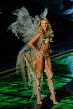 Candice Swanepoel opened the Fairy Tale segment with Hozier performing Take Me to Church. Her look feature handpainted gossamer wings and butterfly inspired thigh high boots.