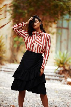 Make a sartorial statement with a little help from the Candy Striped Shirt. This bold piece comes trimmed with an oversized neck tie that can be worn in a bow or left loose for a more languid finish. Temper its relaxed fit with High Waisted Skinny Jean and boots or go matchy-matchy with the Ruffle Wrap Skirt in Stripe.