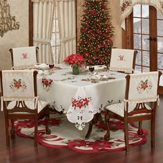 The Poinsettia Palace Table Linens are polyester faux silk in a champagne hue. Designs include poinsettia blossom(s), holly, berries, and ribbon motifs. Christmas Decorations Dinner Table, Christmas Placemats, Christmas Lanterns, Christmas Centerpieces, Holiday Tables, Table Decorations, Christmas Scents, Christmas Home, Christmas Chair Covers