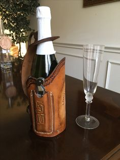 """Commemorative wine server/tote features pocket for corkscrew with a golden """"50"""" on it to celebrate the Loretto Academy Class of '67"""