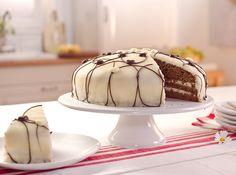 Schoko-Marzipan-Torte Eine saftige Schoko-Torte mit Vanilla-Tortencreme und Marzipan-Decke