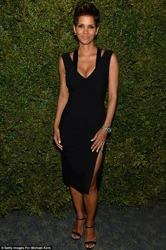 working it mommy style - Figure hugging: On Saturday, Halle wore a tight black dress which hugged her new curves to an event at the Pool Room at the Four Seasons Hotel in New York City