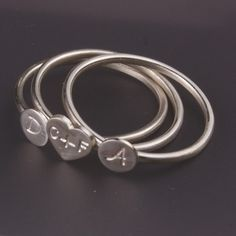 These initial rings are precious. Mom will love the having the whole family put on this custom jewelry.