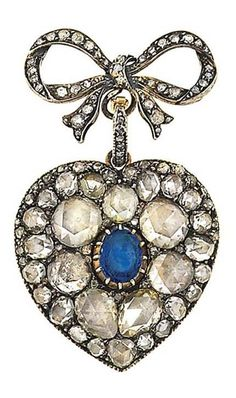 A late 19th / early 20th century diamond and sapphire brooch. The detachable heart-shaped pendant centrally-set with an oval-cut sapphire within a graduated rose-cut diamond surround in foiled closed back settings, to a later reverse with engraved motif, suspended from a rose-cut diamond bow surmount, Dutch marks, 5.0cm long. Maker's mark JRS