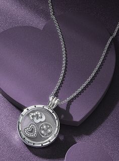 Pandora medium sized locket with 3 petite charms (sold seperatly).