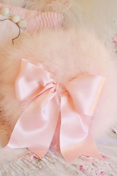 Round Pink Fluffy Pillow with a Pink Satin Bow