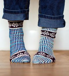 Inspiration for a sock pattern. I like the multicoloured stripes.