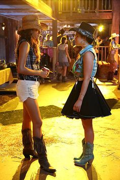 Aria swapped her denim bottoms for a frothy black skirt in this week's episode of Pretty Little Liars. Mimic her party style with this Alice + Olivia A-line number ($396), an embroidered denim shirt, and her exact turquoise Mia girl cowboy boots ($50). Source: ABC Family