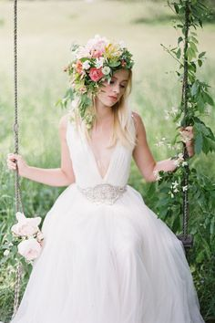 """The circlet trend has grown into a full-on petal posy this summer. """"It features miniature blueberries, blooming vines and mock-orange from the garden, flowers from my tulip poplar tree and locally grown ranunculus and poppies."""""""