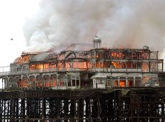 """West Pier Burning: """"The West Pier is a pier in Brighton, England. It was built in 1866 by Eugenius Birch and has been closed and deteriorating since awaiting renovation, although after two fires and several storms, little is left in situ. Brighton England, Brighton Inglaterra, Brighton Sussex, Brighton And Hove, East Sussex, Old Pictures, Old Photos, Bognor Regis, Places To Travel"""