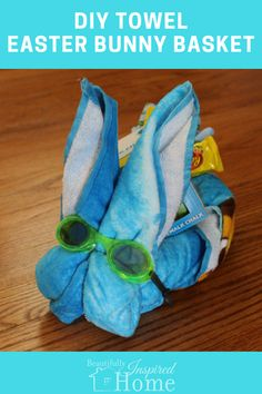 Easy tutorial to make your own beach towel Easter bunny basket. All you need is a towel, rubber band, and goggles to make this cute Easter gift.