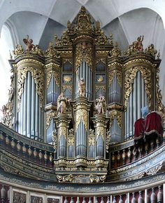 Majestic, highly decorated organ in St. Nikolai Kirche, Luckau, Germany, built in 1672. Apparently the 3 figures rotate.