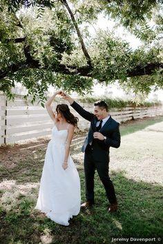 Farm wedding photos, groom twirling bride
