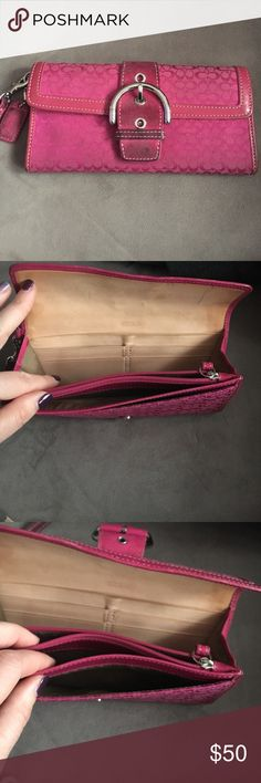 "Coach Soho Signature oversized wallet/wristlet Genuine authentic coach signature logo wallet in pink, used, nonsmoker.  Signature monogram canvas leather trim & buckle.  Hasn't been cleaned or treated but could use it...otherwise in great shape. Nothing frayed or broken. Dimensions 7.5L x 4""H x 3/4""W. Coach Bags Wallets"