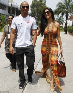 Bright: Nicole Scherzinger went for a floor-length printed frock on race day at the Malaysian Grand Prix