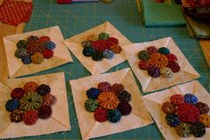 Sew'n Wild Oaks Quilting Blog: Yo-Yo's Galore.  This is an old fashioned and really awesome way to do hand sewn yo yo's on a quilt.  I love it!