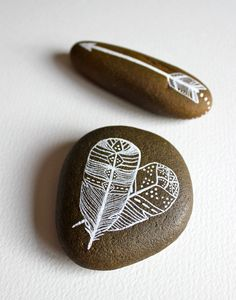 painted rocks. love how simple and sweet these are. you could make cupid's arrow rcks for valentine's day.