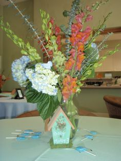 """Hand painted bird house centerpieces for """"baby bird"""" shower for Jen and Cole."""
