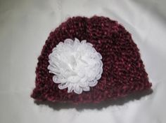 Child's knit hat with ribbon embellishment. by SharonsHomeSewn