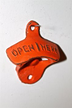 Bright Orange Bottle Opener /Cast Iron /Vintage by AquaXpressions, etsy