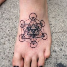 Sacred geometry metatrons cube tattoo on forearm