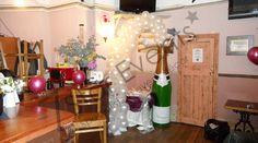 Champagne bottle balloon arch. The White Bear Pub, London