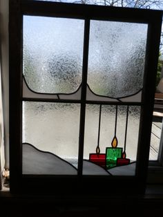 Custom stained glass done in Huntington Indiana. Christmas candles on a frosty day