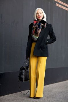 Shop this look on Lookastic:  https://lookastic.com/women/looks/pea-coat-wide-leg-pants-ankle-boots-tote-bag-scarf/13294  — Multi colored Fur Scarf  — Black Pea Coat  — Yellow Wool Wide Leg Pants  — Black Studded Leather Tote Bag  — Black Suede Ankle Boots