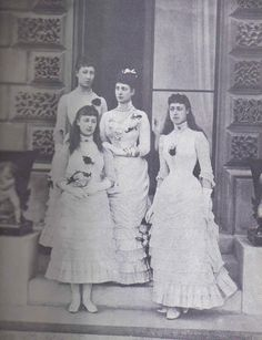 Queen Alexandra-when Princess of Wales- with her three daughters- Louise, Maud and Victoria dressed for the wedding of Princess Beatrice,1885