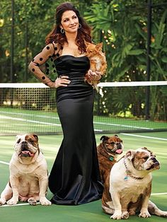 Gloria Estefan with her Bulldogs ... she loves them so much, she had to have THREE (and a mutt). Her Bullies' names are Isaac, Biggie and Noelle.