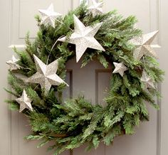Silver star wreath. Stars and evergreens for Christmas??? I could do that. With glitter? Even better.
