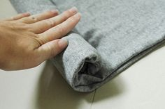 Rolling a shirt can really save space when packing for a trip. Learn how to roll shirts in this free clothing care video. Make sure you smooth out the shirt BEFORE you start to roll, otherwise you'll have some perma-wrinkles. Start with the end that doesn't have the collar and roll it as tightly as possible.