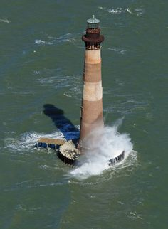 My all time favourite~Unusual perspective of the now abandoned Morris Island Lighthouse between Charleston and Folly Beach. Lighthouse Lighting, Lighthouse Photos, South Carolina Lighthouses, Morris Island, Folly Beach, Beacon Of Light, Abandoned Places, Windmill, Charleston
