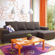 modern sofas with bright cushions are living room furniture design trends