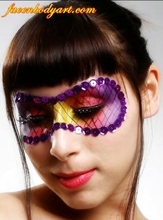 Face painted Mardis Gras mask with sequin detail