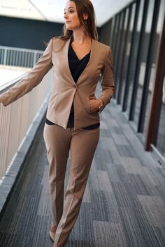 Woman wearing pant suit for business formal attire great for interviews or client meetings