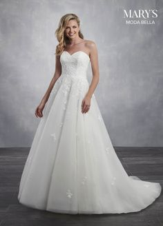 f39a77649d0c Modern A-line tulle overlay wedding dress featuring a strapless sweetheart  neckline and delicate floral lace applique cascading down the skirt. The  gown ...