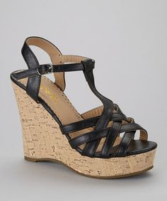 Take a chic ensemble to new heights. Crisscrossed straps and a cork-inspired heel give these lofty wedges a sophisticated style boost.