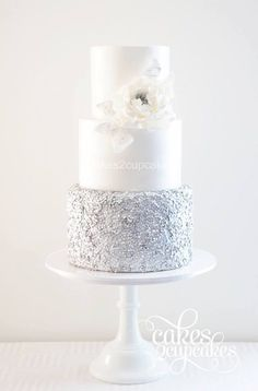 Silver and white wedding cake with white flower | Sequin Wedding Cakes with metallic gold and silver accents via @BelleMagazine