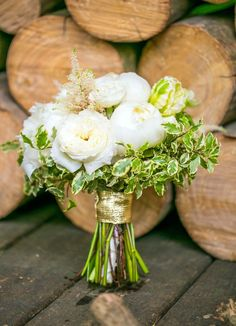 Beautiful white and green bouquet wrapped in gold #wedding #weddingbouquet #gold #goldwedding #bridalbouquet