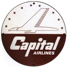 Large Round Capital Airlines sign which depicts a giant eagle flying as if it were a plane.