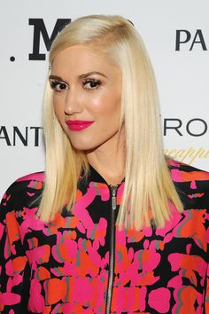 Gwen switched from her signature red to a juicy hot pink lip — and looks stunning both ways.
