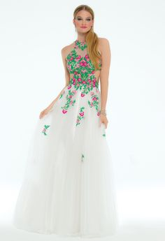 Be a petal pusher in this blossoming prom dress! The floral embroidered jewel neckline, fitted illusion bodice, mesh A-line skirt, and tie back waist make this evening dress irresistible. #camillelavie #CLVprom17
