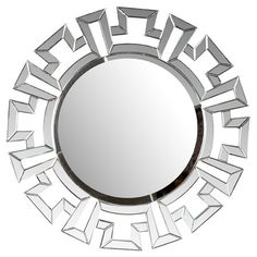 Surrounded by a geometric beveled frame, this chic wall mirror is perfect anchoring a collage or accenting your powder room decor.