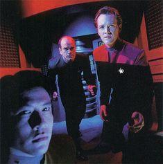 Action! Garrett Wang, Robert Picardo, and Robert Duncan McNeill strike a pose for a 1995 photo shoot.