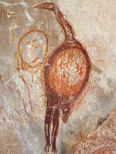 Kimberley, Australia - painting of an emu - ON a smooth cave wall in the Kimberley wilderness, an ochre handprint radiates vitality. Two fingers are angled, as if poised for action. This human hand could have just touched the rock and left its warm imprint inside its stencilled silhouette.