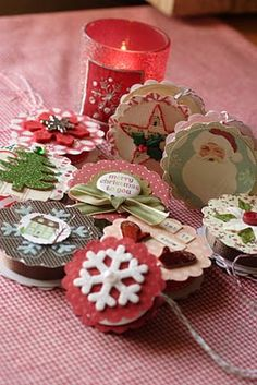 handmade ornaments made from ribbon spools. (I would put duct tape or washi tape on spool edges.)