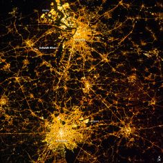 An astronaut on the International Space Station took this night photograph of two of Belgium's major metropolitan areas. Antwerp is a major European port located on the Scheldt River, which appears as a black line angling through the lights. The city has access to the Atlantic Ocean, and its extensive dock facilities are even more brightly lit than the city center.